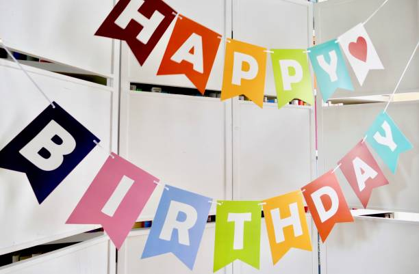 happy birthday text on  white wooden wall - happy birthday banner stock photos and pictures