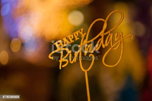 istock Happy Birthday text sign topper stick on the top of bouquets blurred in bokeh background. 878096668