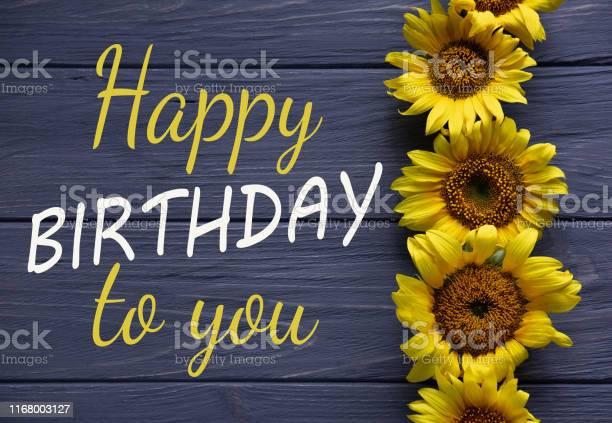 Happy birthday to you birthday greeting card with flowers on a wooden picture id1168003127?b=1&k=6&m=1168003127&s=612x612&h=ubhx ukb3mstbg8ydimtcir8uuk0hrjkfgm4 lekre8=