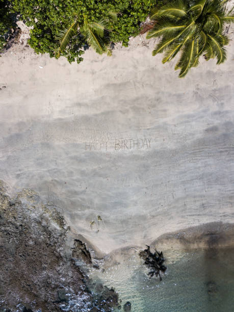 Happy Birthday Written In The Sand On Beach Stock Photo