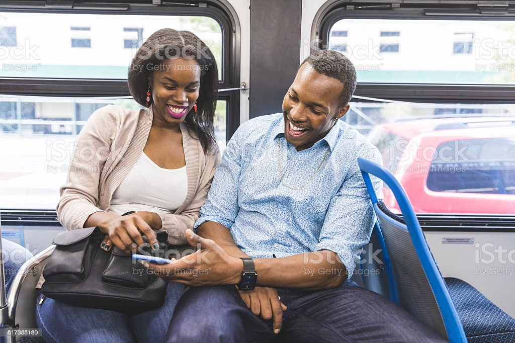 Happy black couple travelling by bus in Chicago stock photo