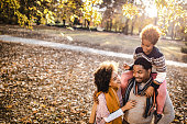 istock Happy black family spending an autumn day at the park. 1220077976