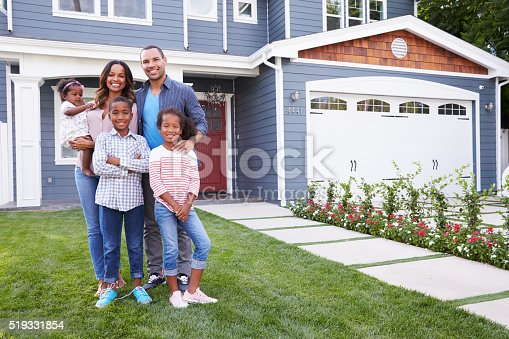 istock Happy black family standing outside their house 519331854