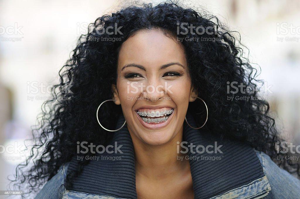 Happy black girl with braces stock photo
