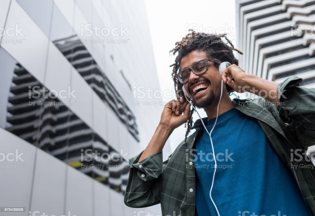 Happy black man listening music in complete enjoyment and happiness...
