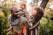 istock Happy black parents having fun with their daughter at the park. 1162082801