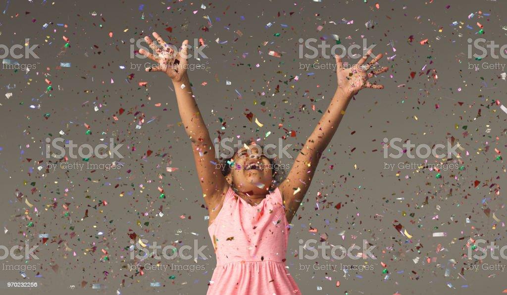 Happy black small girl at white studio background stock photo