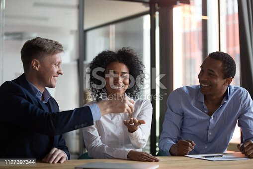 istock Happy black woman receiving keys from new home 1127397344