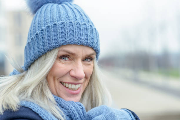Happy blond woman with a vivacious smile stock photo