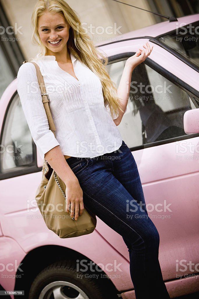 Happy Blond Woman with her little pink car in London royalty-free stock photo