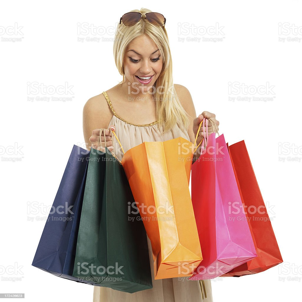 Happy blonde with shopping bags royalty-free stock photo