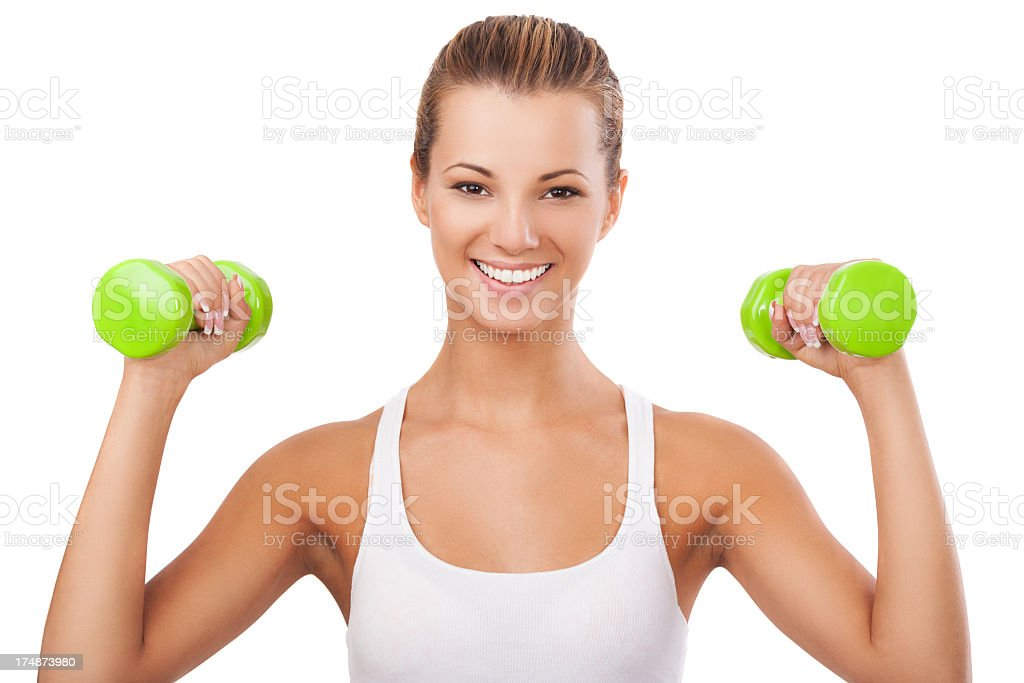 Happy blonde woman exercising with weights Young girl holding weights, smiling and  showing muscles 25-29 Years Stock Photo