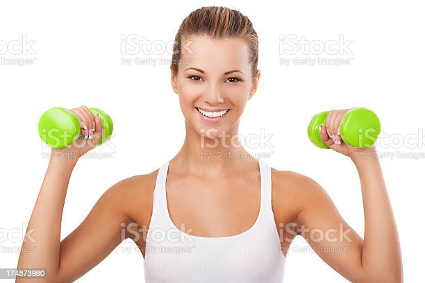 Happy Blonde Woman Exercising With Weights Stock Photo - Download Image Now