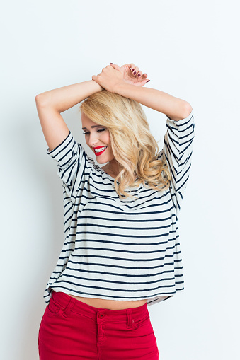 Happy Blonde Woman Wearing Striped Blouse Raised Arms Stock Photo - Download Image Now
