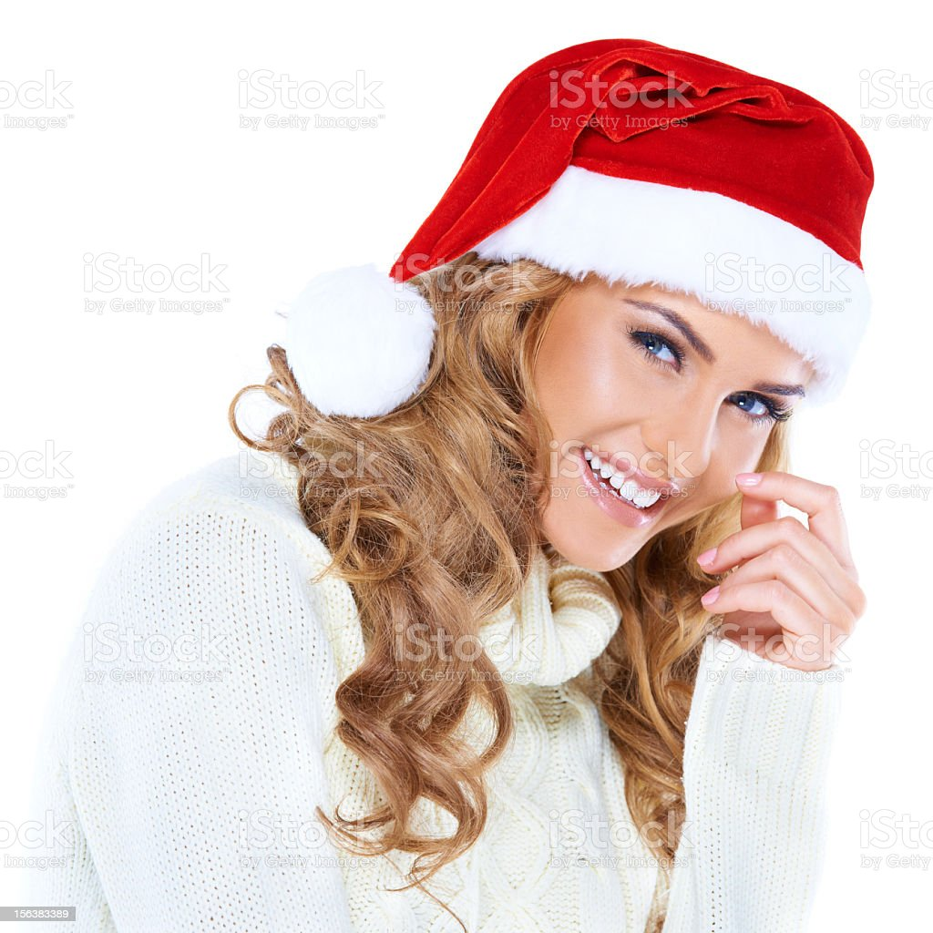 Happy blonde woman with a red Santa hat royalty-free stock photo