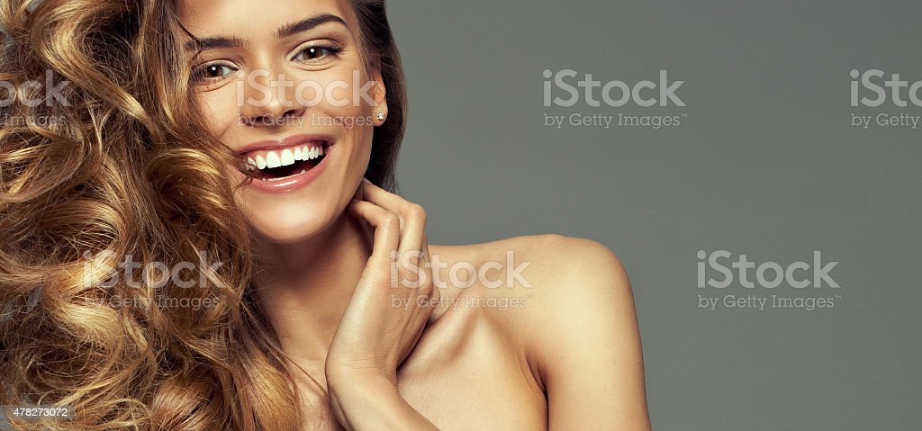 Happy blonde woman with copy space for your text stock photo
