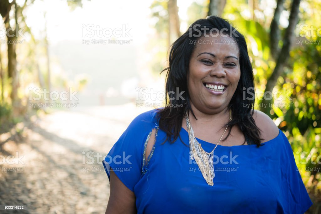 Happy body positive woman wearing blue clothes stock photo