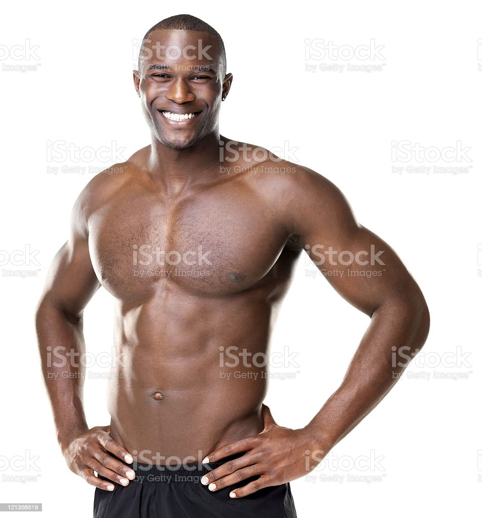 Happy bodybuilder with muscular physique posing against white background stock photo