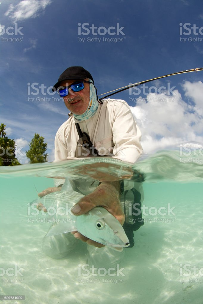 happy bonefisherman stock photo