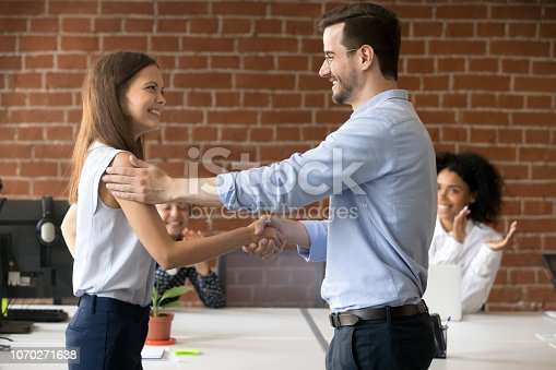 istock Happy boss handshaking successful employee congratulating with job promotion 1070271638