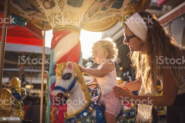 Happy boy and mother on carousel picture id667293226?b=1&k=6&m=667293226&s=612x612&h=h2hhizb6tkdiys1zu38ffyqfaan9axs8ylvgtjepzxq=