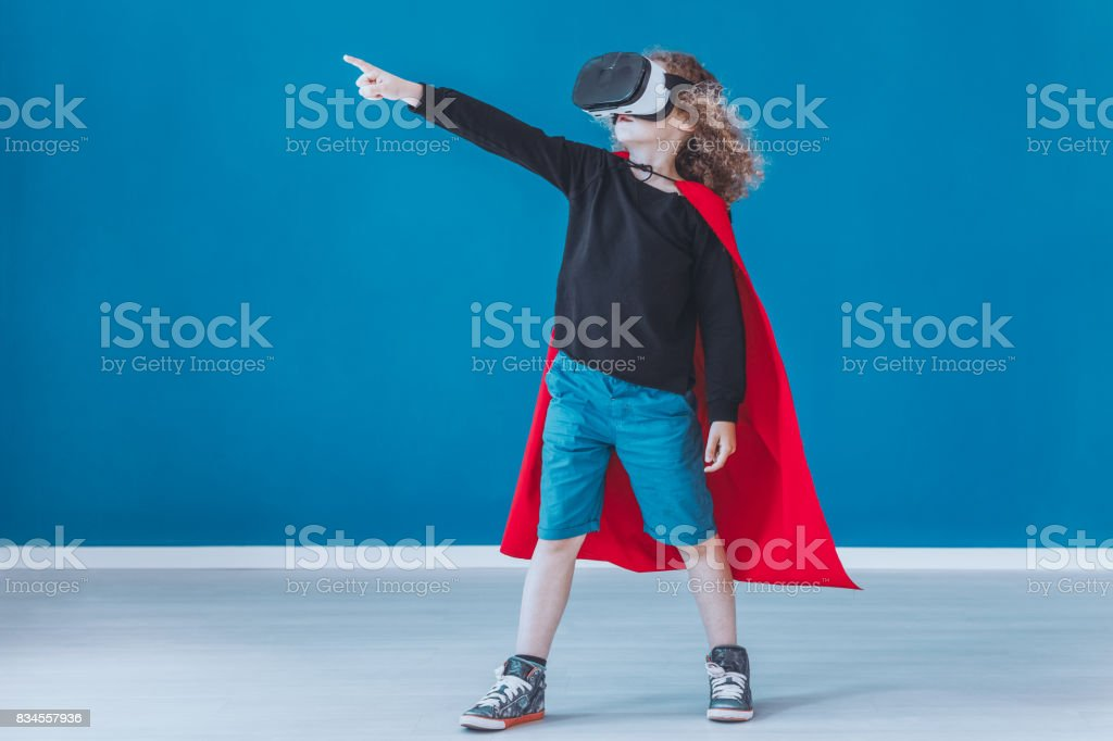 Happy boy dressed up as a superhero stock photo