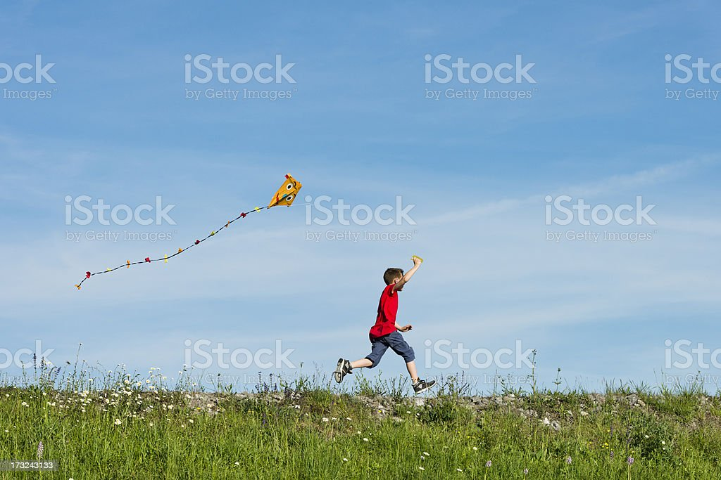 happy boy flying his kite stock photo