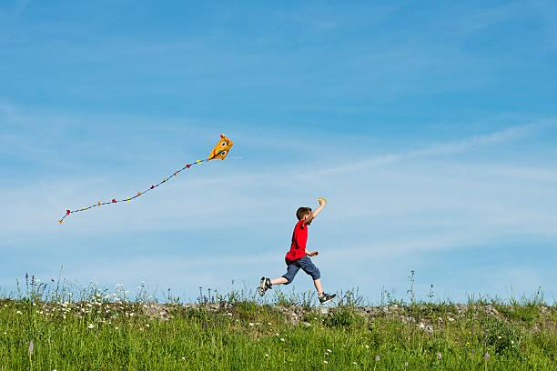 happy boy flying his kite stock photo