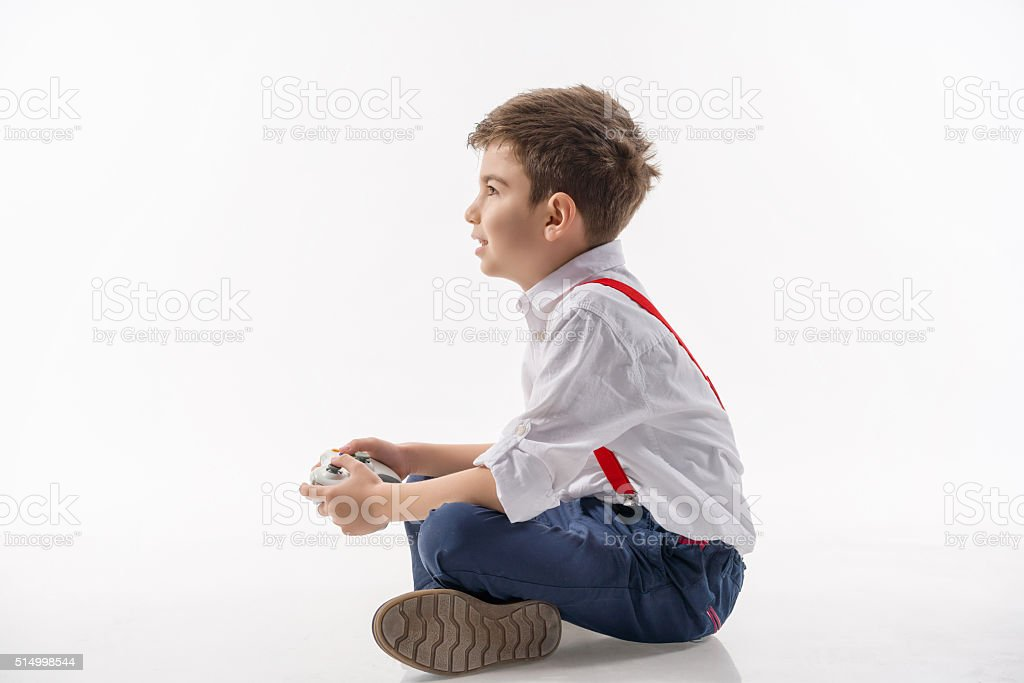 Happy boy gamer stock photo