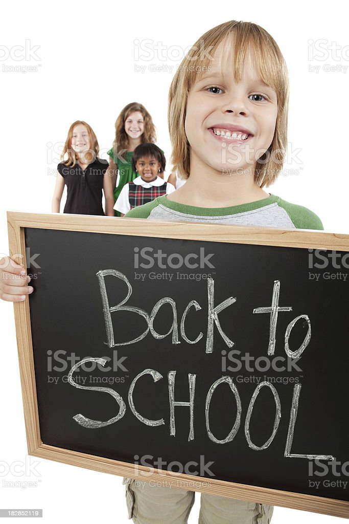 Happy Boy Holding Back to School Sign With Other Students royalty-free stock photo
