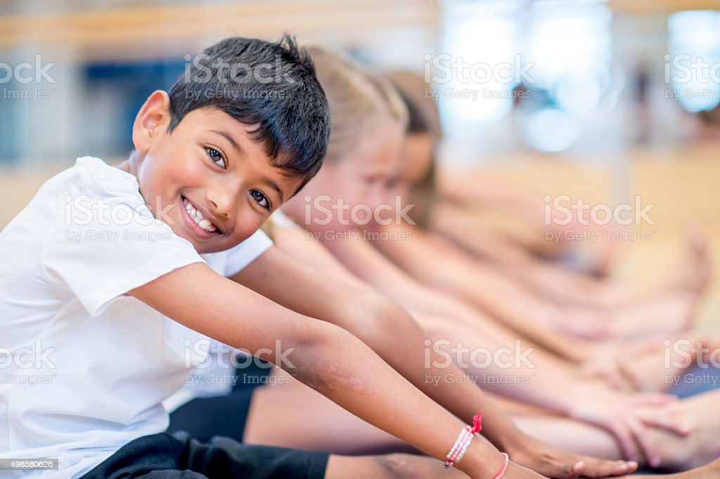 Happy Boy in an Exercise Class stock photo
