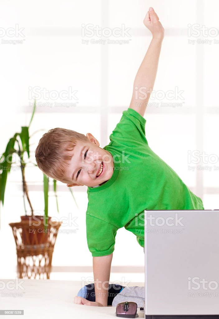 Happy boy in front of laptop royalty-free stock photo