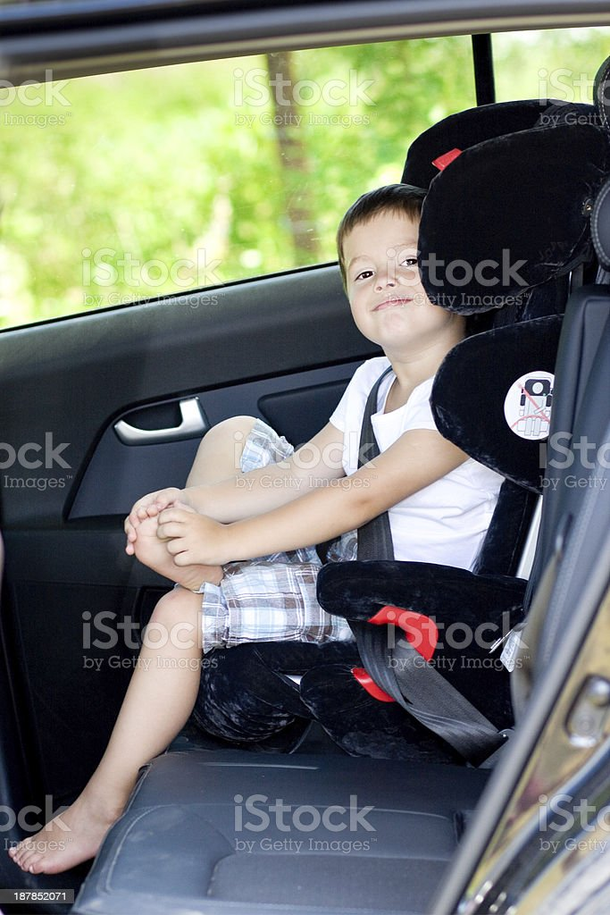 Happy boy in his child safety car seat royalty-free stock photo