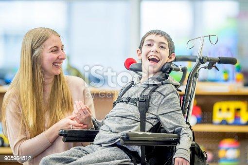 istock Happy Boy In Wheelchair 905964512