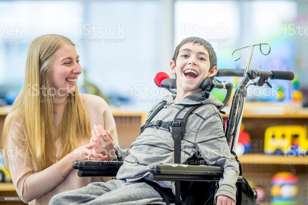 Happy Boy In Wheelchair stock photo