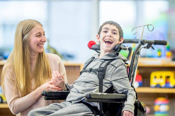 Happy Boy In Wheelchair stock photo