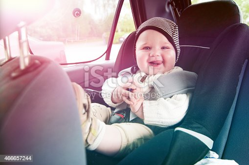 istock Happy boy is secure in a baby car seat 466657244