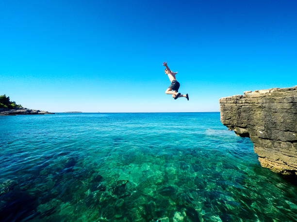 happy boy jumping in the croatian sea happy boy jumping in the croatian sea taking the plunge stock pictures, royalty-free photos & images