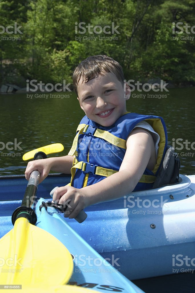 Happy boy kayaking royalty-free stock photo