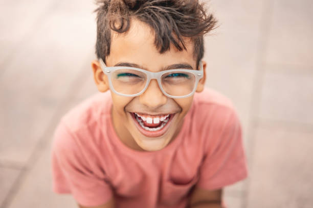Happy boy laughing outdoors Excitement, Mixed Race Person, Outdoors, 8-9 Years, Beautiful People 8 9 years stock pictures, royalty-free photos & images