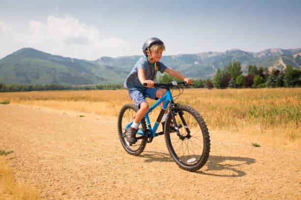 Happy Boy Mountain Biking In The Mountains stock photo