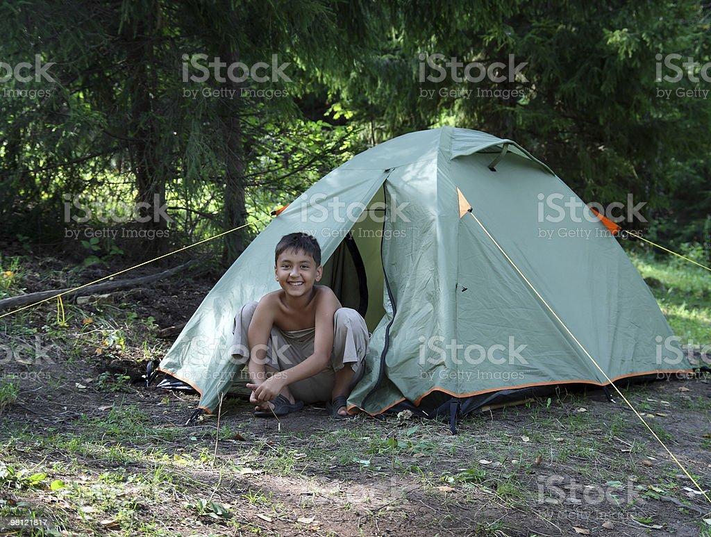 happy boy near camping tent royalty-free stock photo