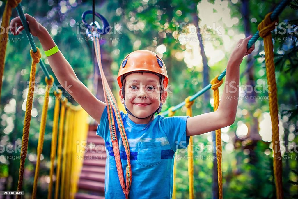 happy boy on the zipline stock photo