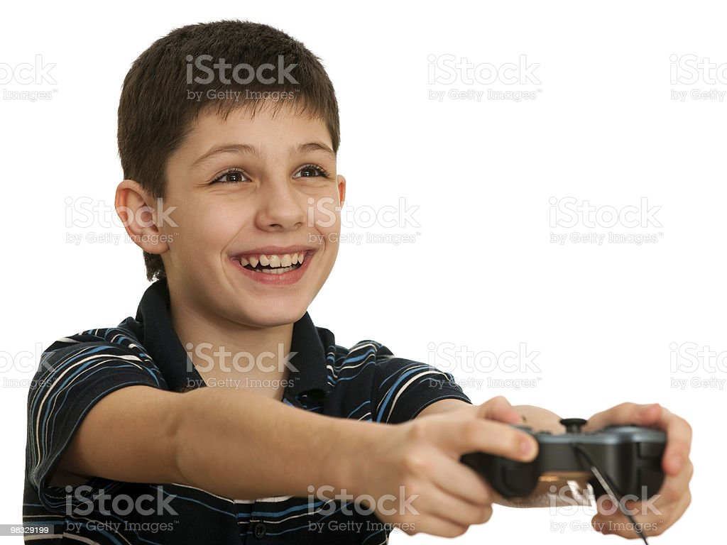 Happy boy playing a computer game with joystick royalty-free stock photo