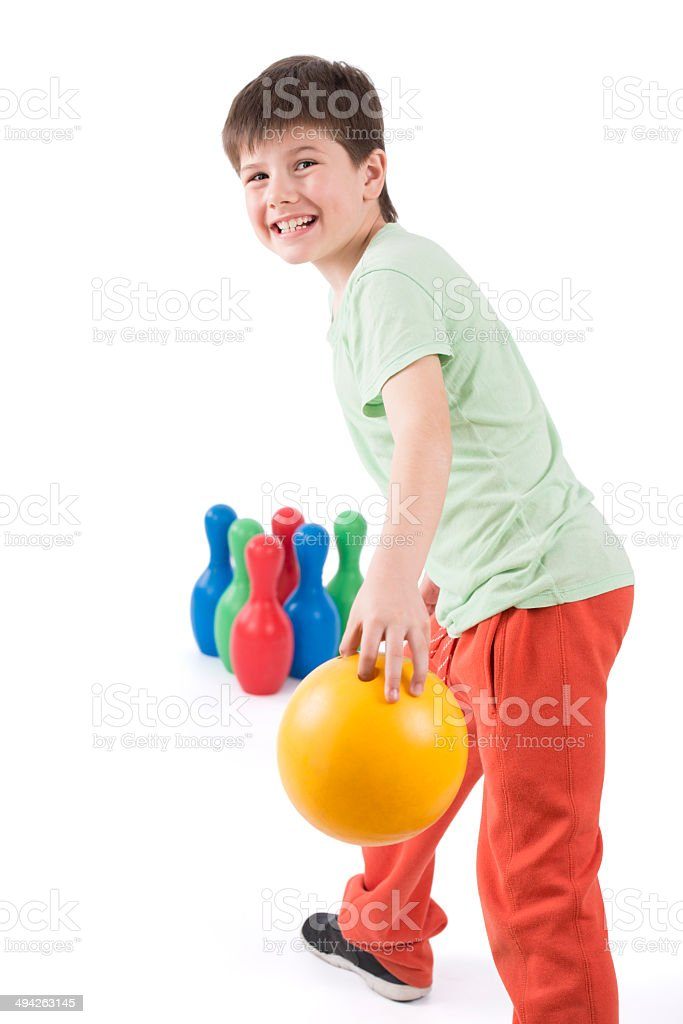 Happy boy playing bowling. royalty-free stock photo