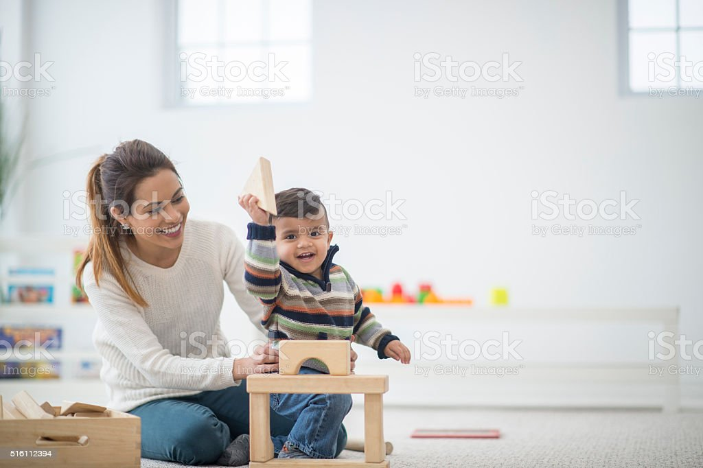 Happy Boy Playing with Blocks stock photo