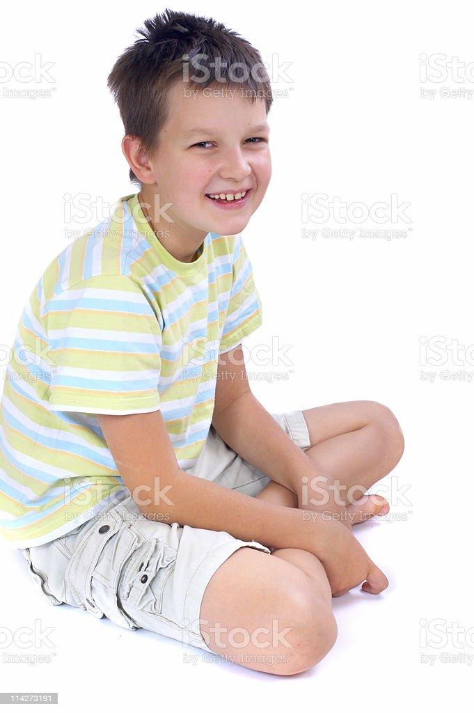 Happy boy sitting on floor royalty-free stock photo