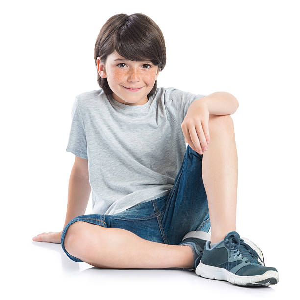happy boy sitting - sitting on floor stock photos and pictures
