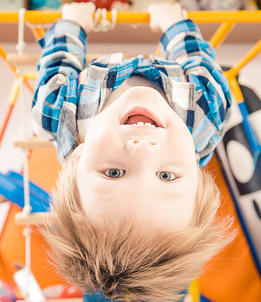 happy boy upside down stock photo