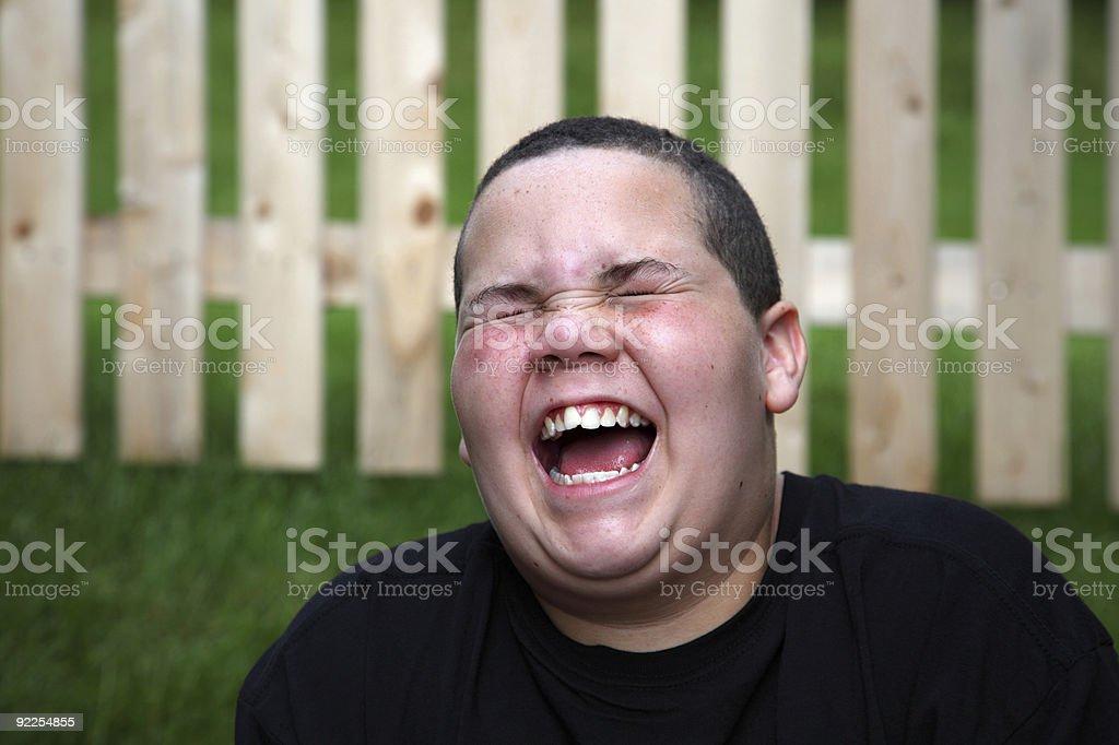 A happy boy wearing a black shirt stock photo